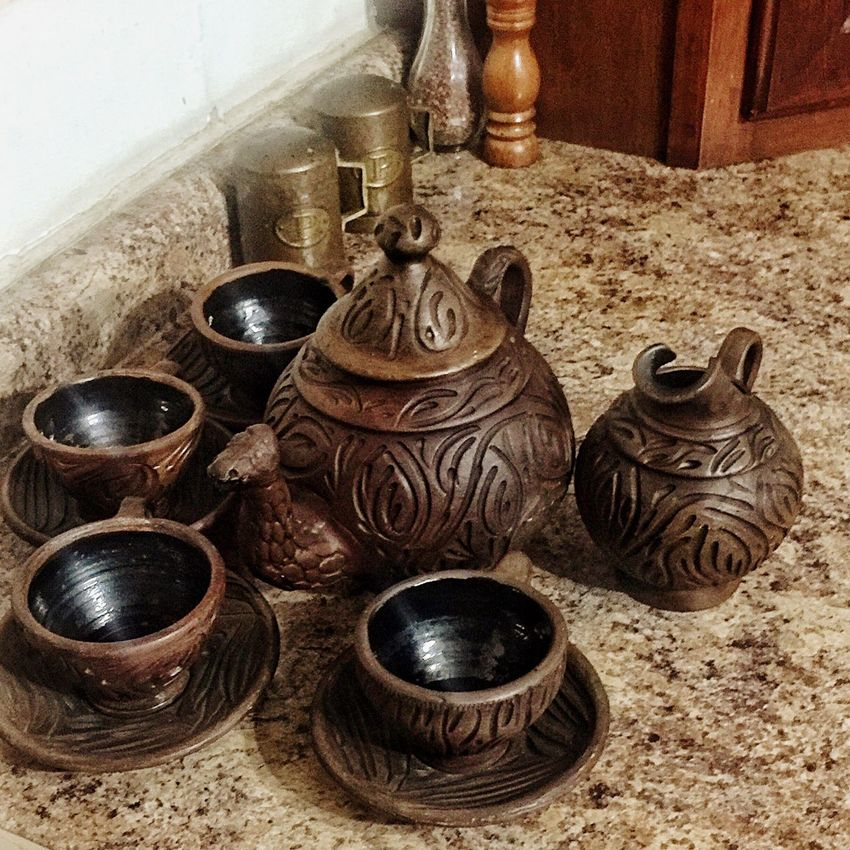 Need help with this very old tea set made out of dark clay I inherited but don't know it's origin Antique Old Tea Pots Clay Work Old-fashioned Claypot Clay Art Indoors  Still Life Cultures Metal Antique No People Decorative Urn Teapot Pottery Close-up