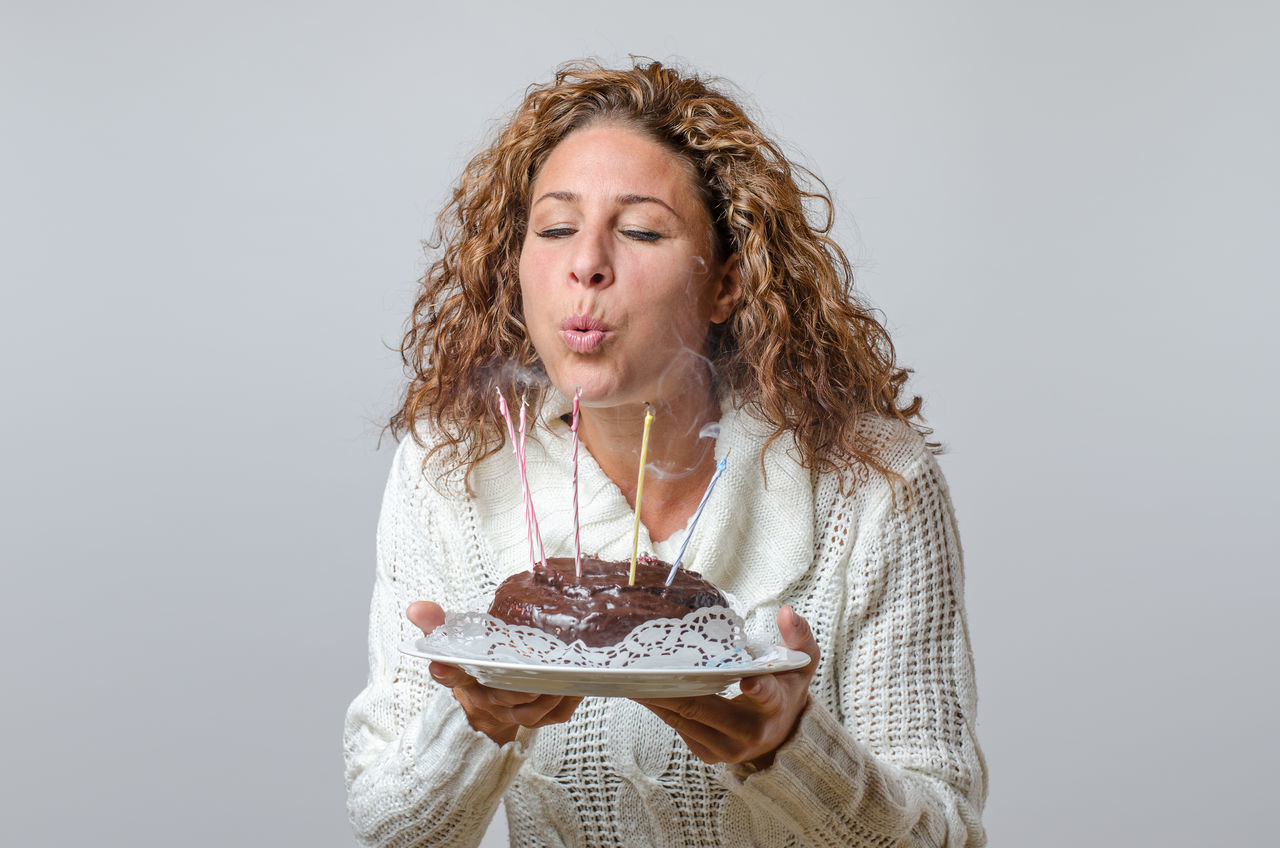 Beautiful stock photos of candle,  40-44 Years,  Birthday Cake,  Blowing,  Brown Hair
