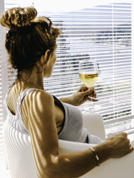 """""""Wine brings to light the hidden secrets of the soul"""" -Horace- Alcohol Celebration Champagne Champagne Flute Close-up Day Drink Drinking Glass Food And Drink Holding Indoors  Lifestyles Luxury One Person People Real People Wine Wineglass Women Young Adult Wine Not Sommergefühle"""
