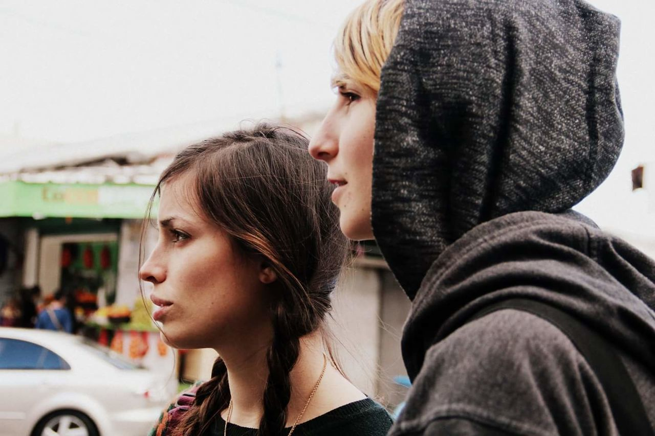 Close-Up Of Two Beautiful Women In City