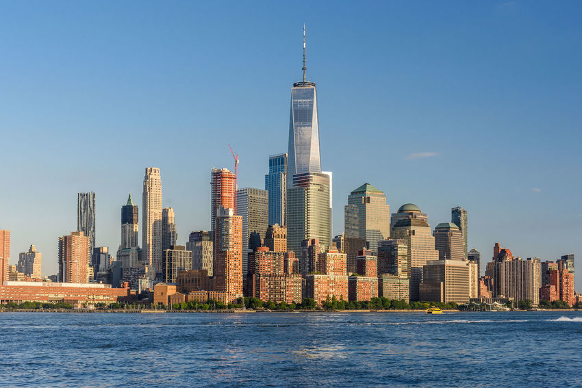 Manhattan New York City USA Architecture Building Exterior Built Structure City Cityscape Clear Sky Downtown District Financial District  Modern No People Office Building Exterior Office Park Outdoors Sea Skyscraper Tall - High Tower Travel Travel Destinations Urban Skyline Water Waterfront