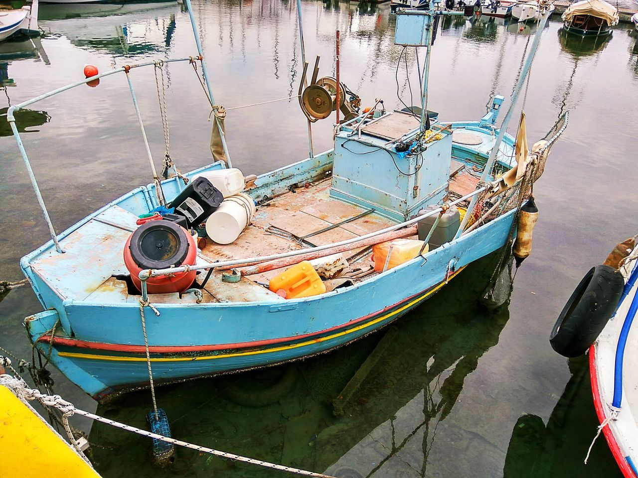 Boat Old Boat Water Nautical Vessel Reflection No People Outdoors Close-up Day Reflection In The Water Sea Fishing Boat Smartphonephotography Old Painting Contortion City Backround Sea_collection Sea Life Classic Marina Transportation Vintage Nature Fishing Port Fishing Life