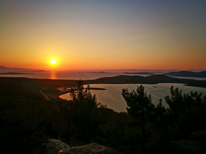 Devil`s hill Sunset Scenics Landscape Sky Silhouette Sun Beauty In Nature Sunlight Tranquility Nature Horizon Over Water Outdoors No People Tree Water Travel Destinations Sea Mountain Horizon Dawn Mytilene Mytileneisland Ayvalık Turkey Devil`s Hill