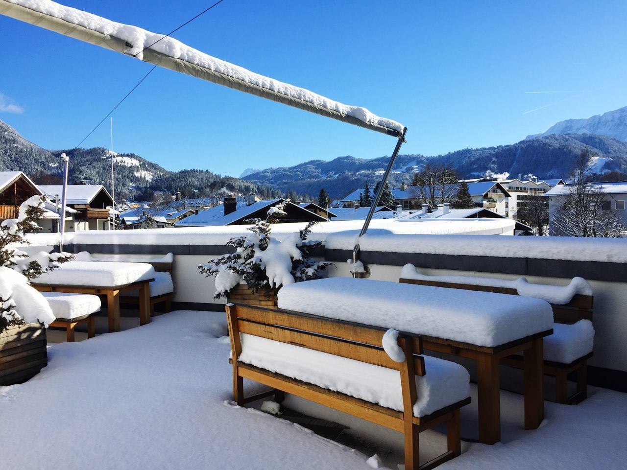 Empty Bench On Snow Covered Mountain Against Clear Sky
