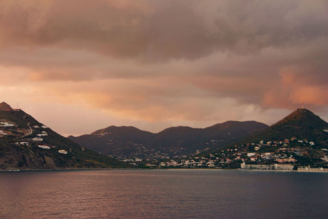 Beauty In Nature Caribbean Cloud - Sky Dramatic Sky Majestic Mountain Mountain Range Outdoors Pink Color Rose Colored Sky Rosy Scenics Tranquility Travel Destinations Vacations Waterfront