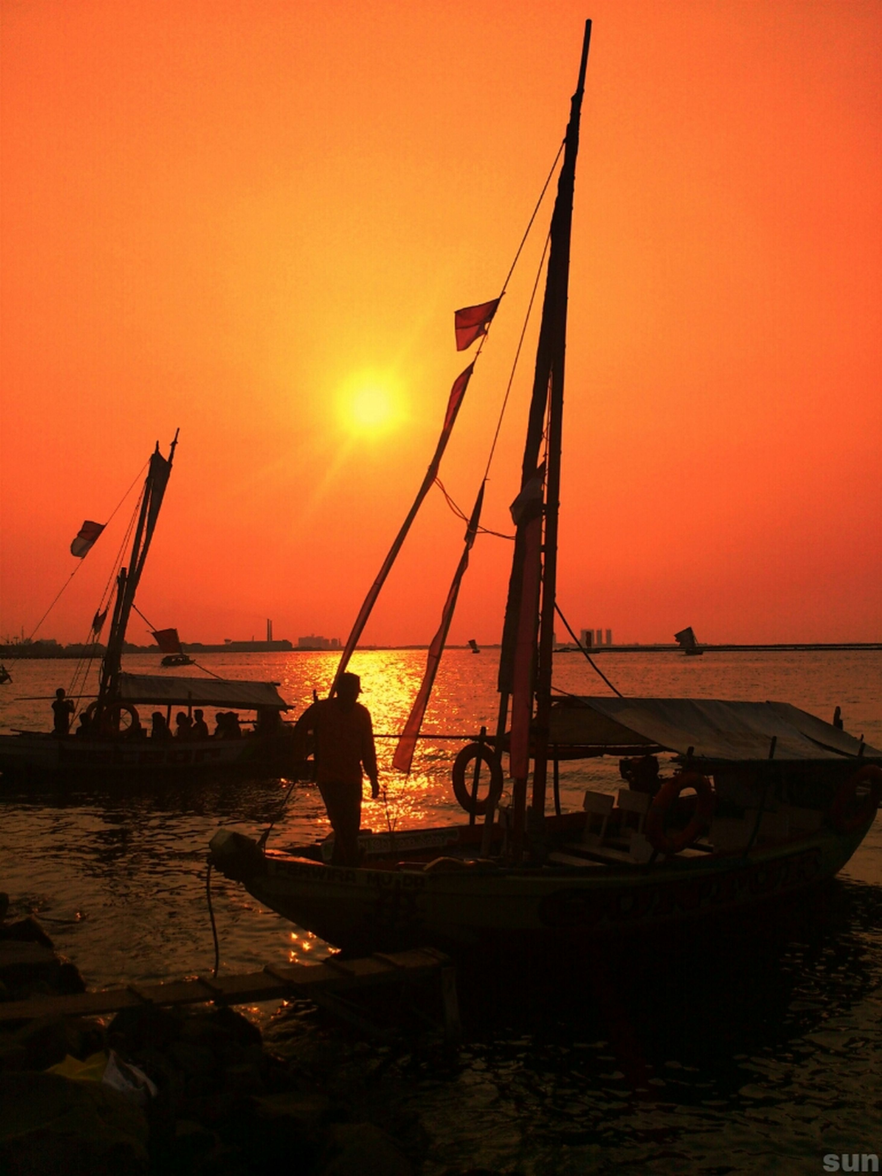 sunset, transportation, nautical vessel, water, mode of transport, boat, orange color, sea, silhouette, sun, moored, mast, scenics, sky, beauty in nature, tranquil scene, travel, horizon over water, tranquility, sailboat