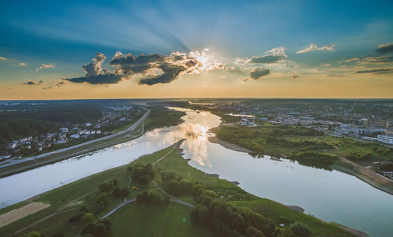 Aerial image of Kaunas city, Lithuania. Summer sunset time. Baltic Countries Clouds And Sky Europe Kaunas Landscape Nemunas Neris No People Outdoors River Sky Sunbeam Sunset