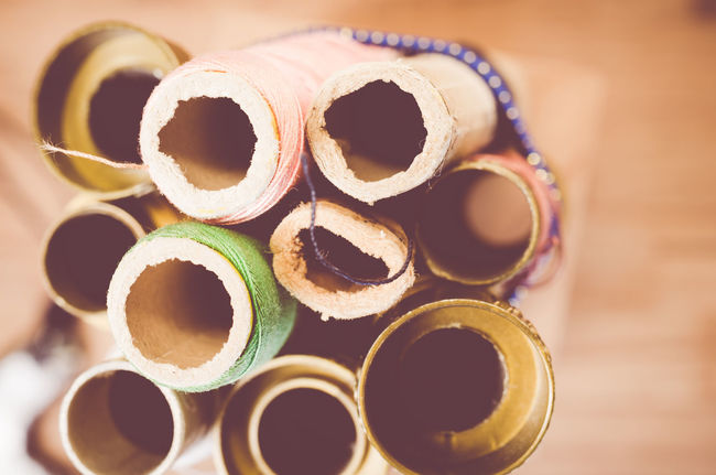 old cotton thread reel - common objects backgrounds Abstract Arrangement Circle Close-up Common Objects Cotton Cotton Ree Cotton Thread Reel Design Detail Filtered Image Full Frame Ideas Indoors  No People Pattern Repetition Retro Styled Selective Focus Set Of Shape Still Life