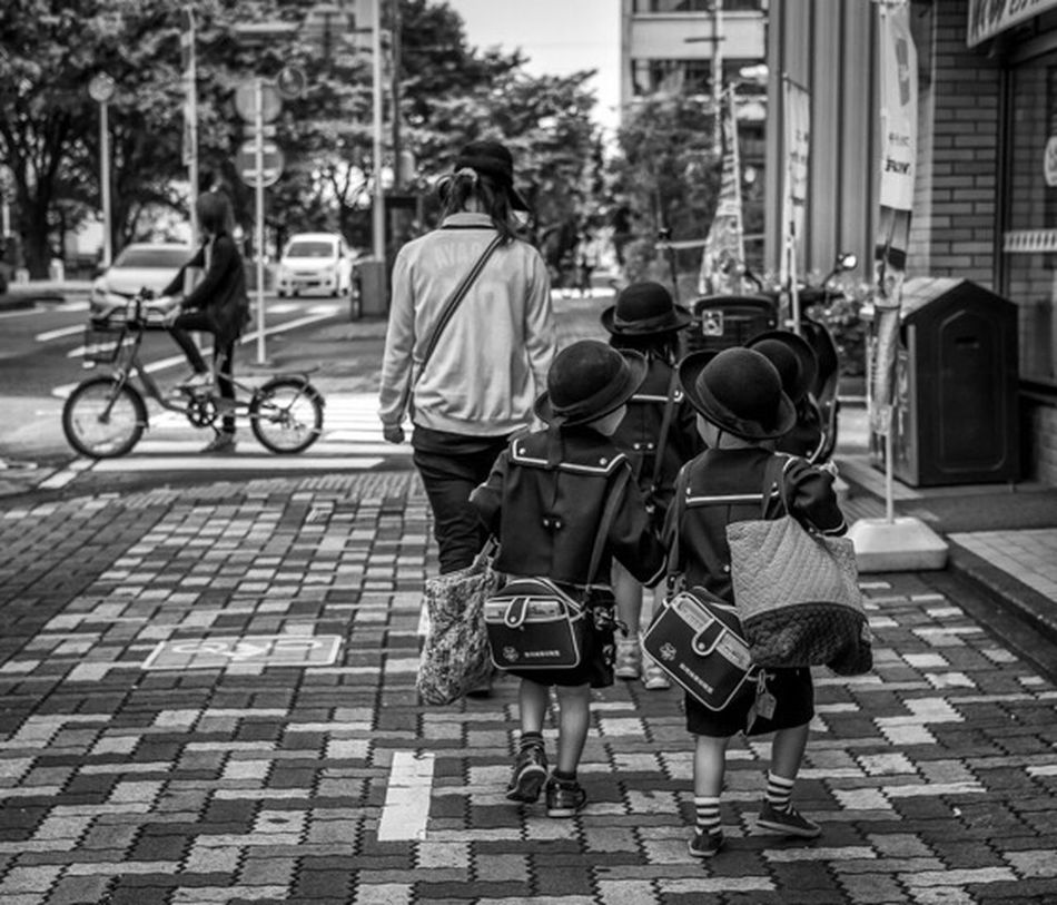Return to Innocence Japan Japanese  Japan Photography ASIA Street Streetphoto_bw Streetphotography Blackandwhite Monochrome Urban City People Candid Uniform Hats Bags Cute Xpro2 Fujixpro2 FujifilmXPro2 Xf35mm Fujifilm_xseries Fujifilm Cooljapan Ultimate Japan