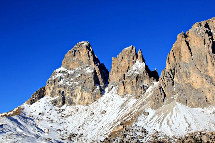 Beauty In Nature Blue Clear Sky Cold Temperature Day Dolomiten Dolomites Dolomites, Italy Landscape Mountain Mountain Range Nature No People Outdoors Rock - Object Scenics Sky Snow Snowcapped Mountain Sossolungo