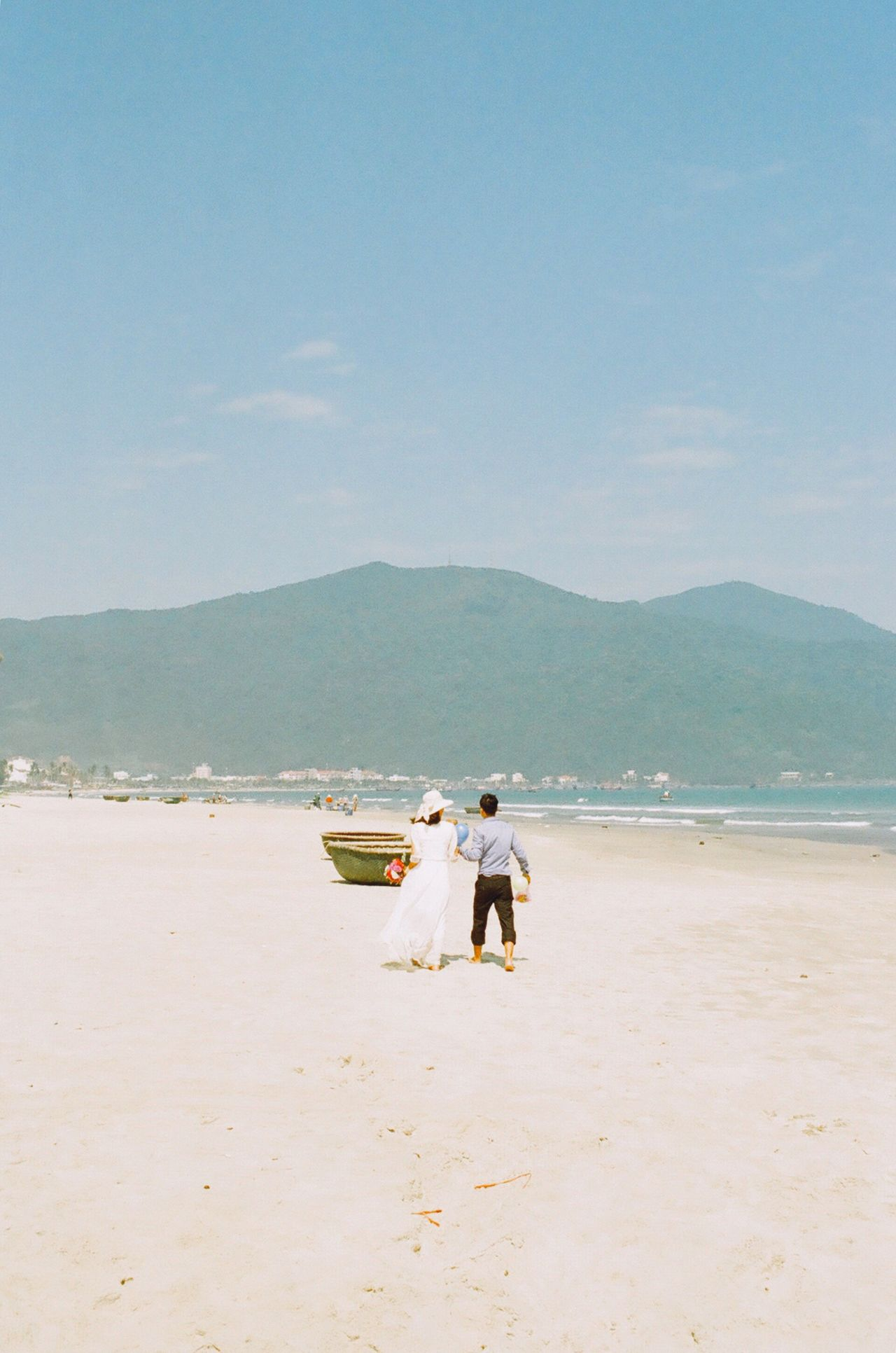 Film Filmisnotdead Analogue Photography Capture The Moment Vietnam Danang Wedding Photography Beach Sea Water Nature Shore Real People Beauty In Nature Sky Outdoors Scenics Sand Mountain Clear Sky Men Day Horizon Over Water