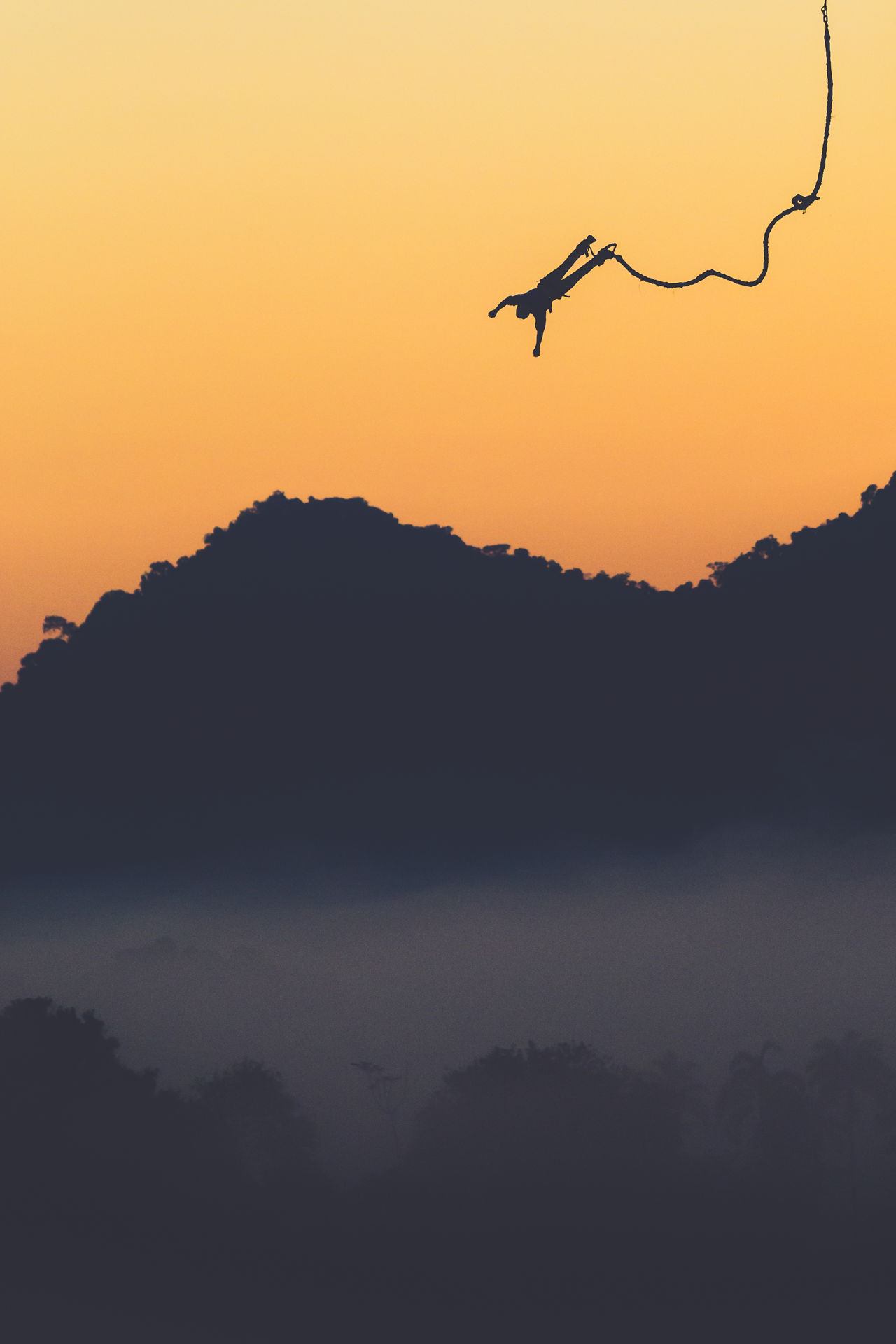 Beauty In Nature Bungee Jumping Clear Sky Day Flying Fog Haze Mountain Nature Outdoors People Scenics Silhouette Sky Tranquility