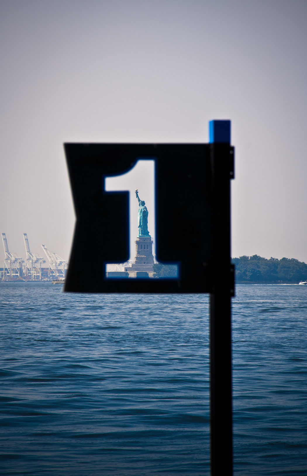 1 Architecture Lady Liberty Looking Through Looking Through An Object New York New York City No People One Outdoors Pier Pier 1 Sea Sign Sky Statue Of Liberty Tranquility Travel Traveling Water Neighborhood Map