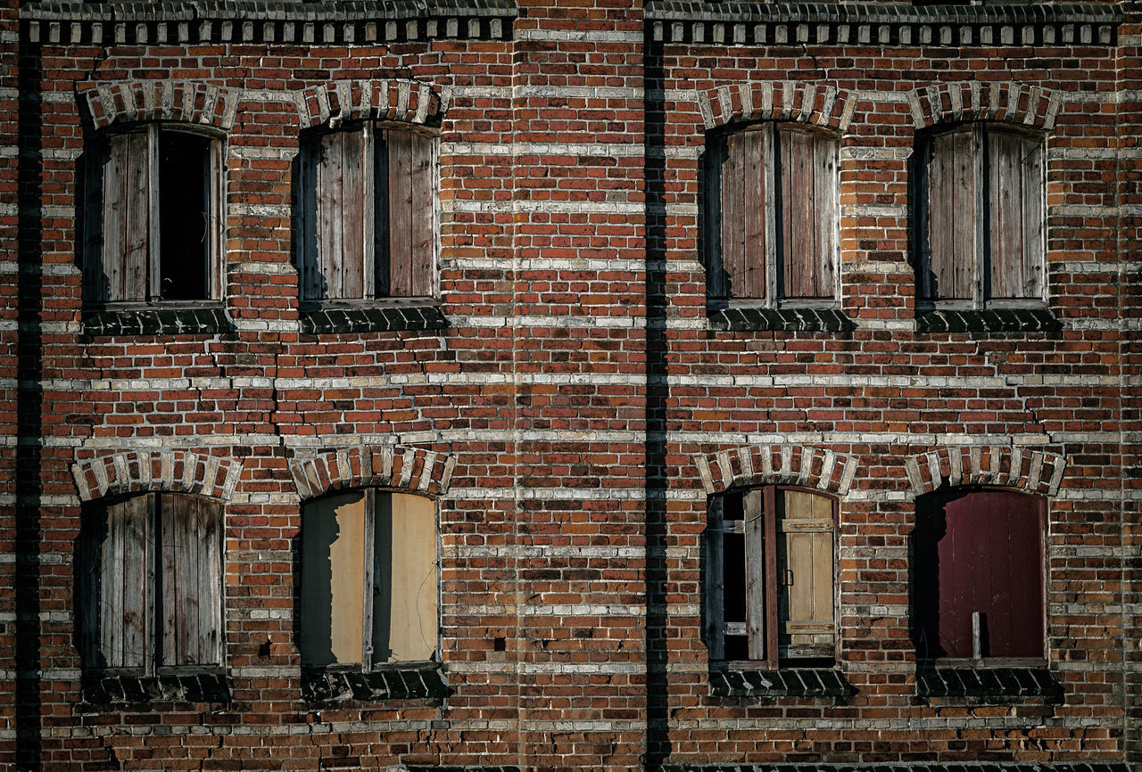 Windows On Brick Wall Of Old Library