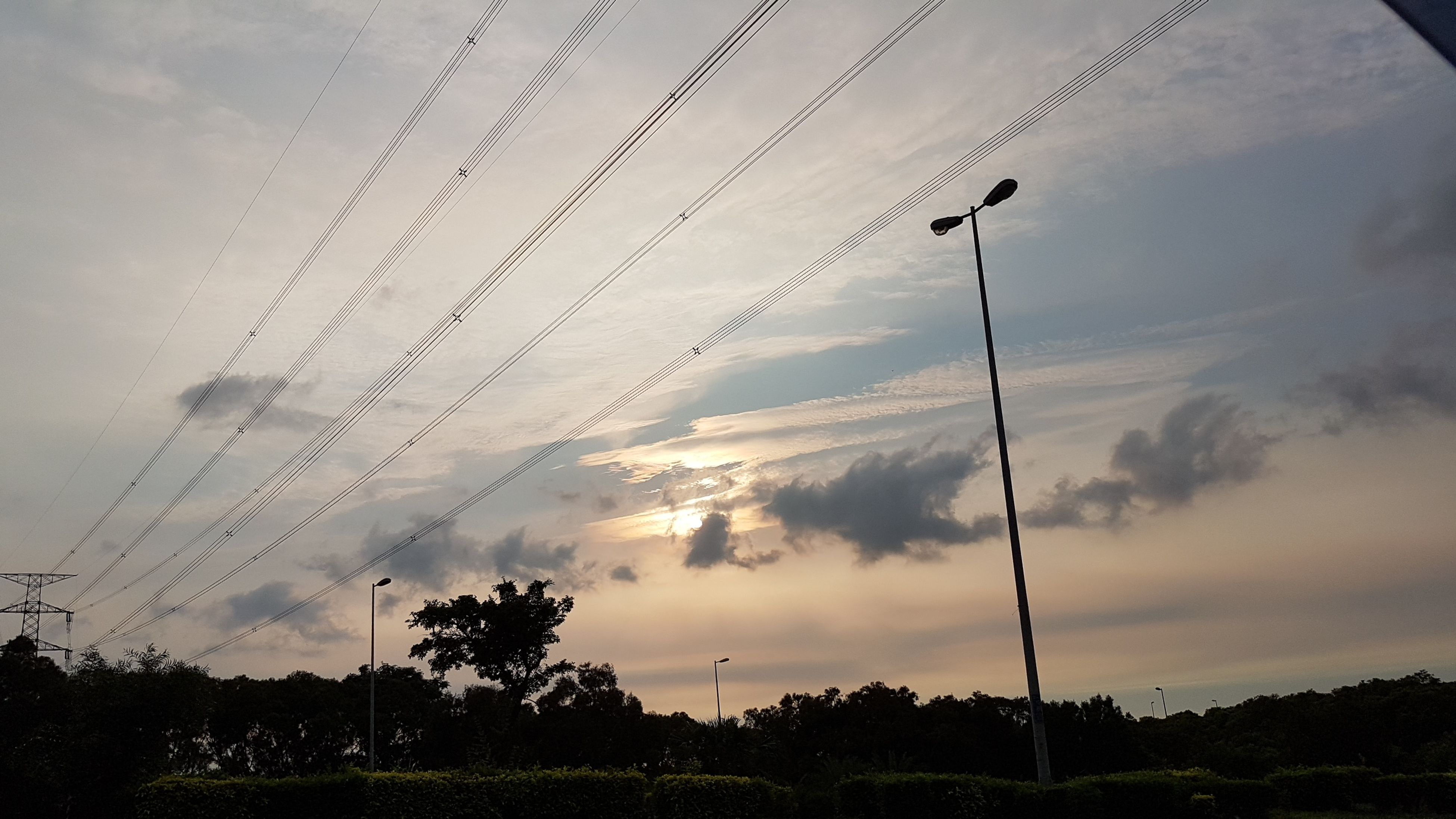 cable, cloud - sky, sky, low angle view, electricity, connection, tree, power line, no people, sunset, technology, power supply, electricity pylon, nature, silhouette, street light, outdoors, beauty in nature, scenics, telephone line, day