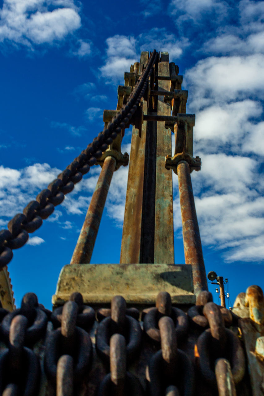 cloud - sky, sky, metal, day, low angle view, history, ancient, religion, no people, built structure, spirituality, rusty, architecture, outdoors, ancient civilization, close-up