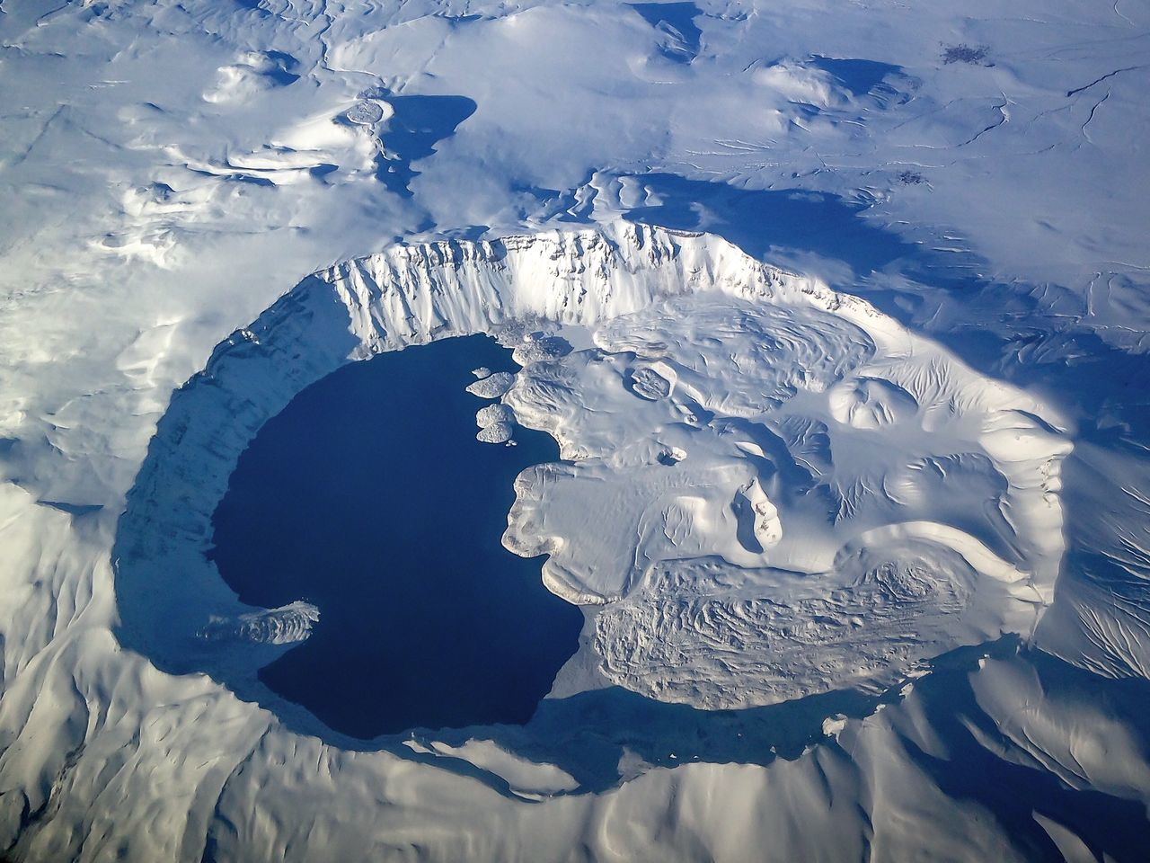 From An Airplane Window Crater Lake Snow Traveling