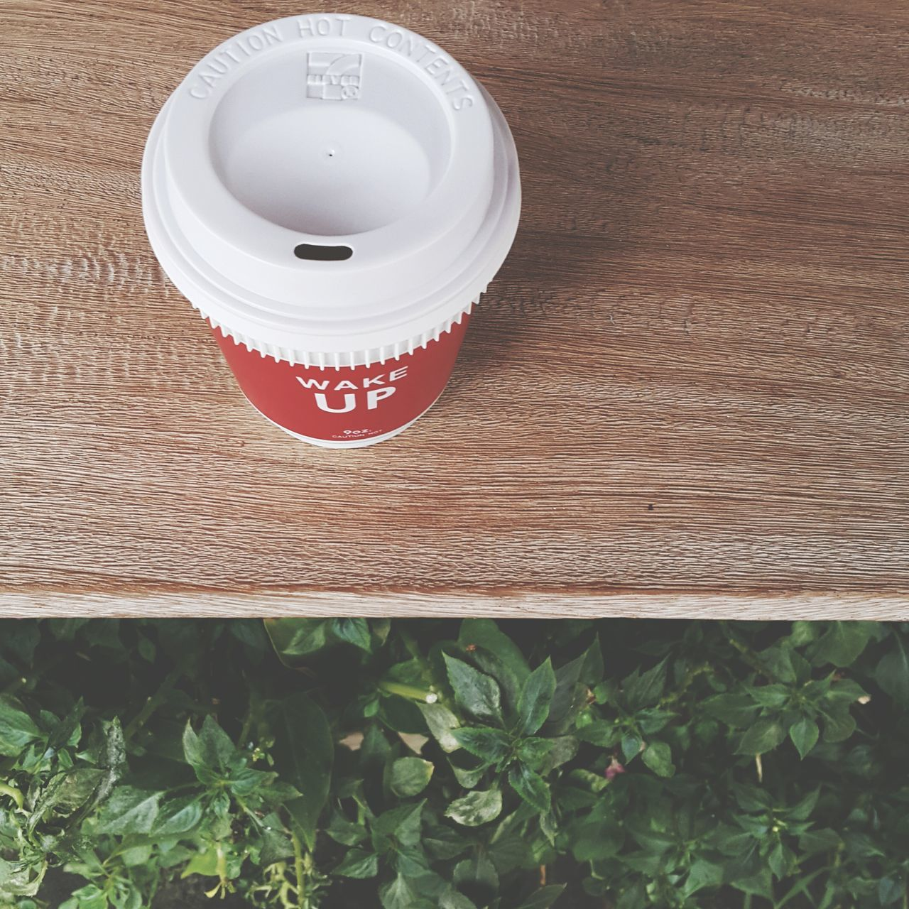 High Angle View Of Disposable Coffee Cup On Table