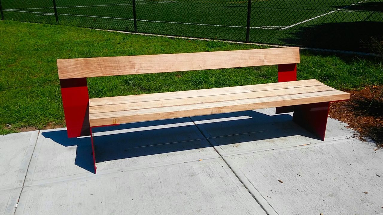 Bench Empty Absence Seat Wood - Material Park Bench Wooden Park - Man Made Space Plank Relaxation Shadow Multi Colored Outdoors Tranquility Park Man Made Object Day Close-up Sports Field Sunny Day Unique Design Recreational Outdoor Grassfield Landscape Green