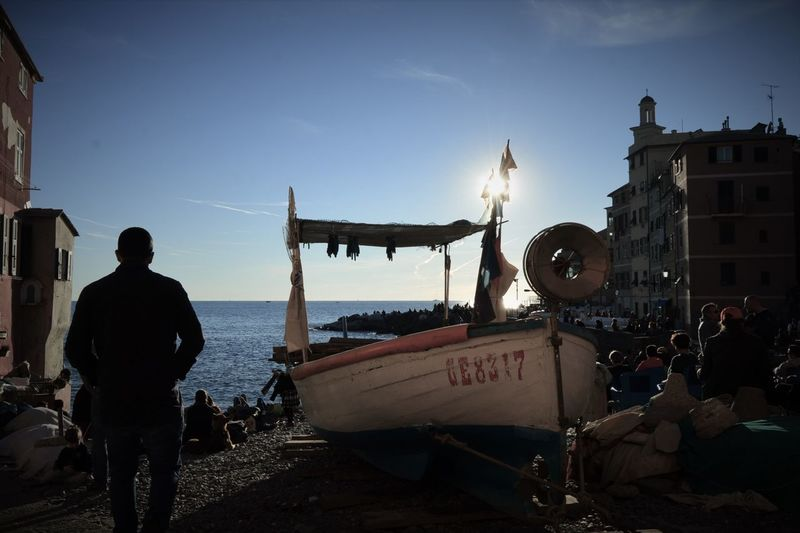 Camogli Italia Fishing Boat Only Men Outdoors Rear View Sky Travel Destinations Vacations
