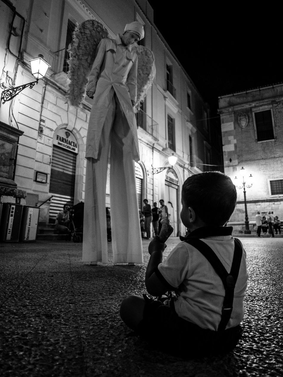 Angel Blackandwhite Close-up Icecream Kid Stilter Stilts Streetphotography Up Close Street Photography Wide Angle My Favorite Photo Street Photographer-2016 Eyem Awards The Street Photographer - 2016 EyeEm Awards The Essence Of Summer The Photojournalist - 2016 EyeEm Awards Two Is Better Than One People And Places Monochrome Photography