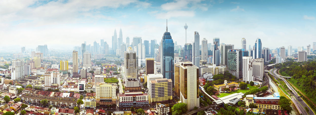 Panorama cityscape view in the middle of Kuala Lumpur city center , early morning with little mist , Malaysia . Aerial View Architecture Building Exterior Business City Cityscape Day Downtown District No People Outdoors Sky Skyscraper Travel Travel Destinations Urban Skyline
