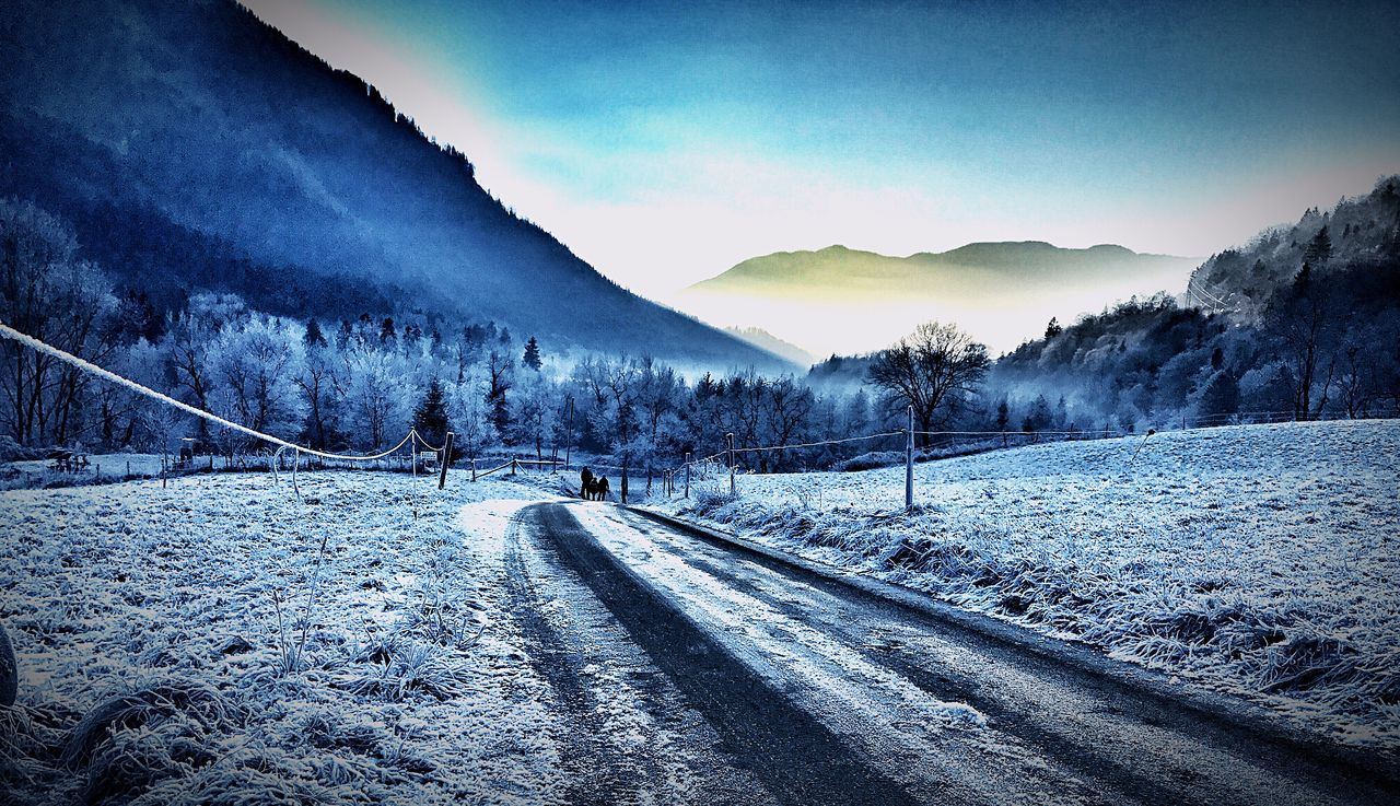 snow, cold temperature, winter, mountain, nature, weather, tranquil scene, scenics, tranquility, transportation, mountain range, outdoors, beauty in nature, the way forward, no people, sky, day, road, landscape, tree