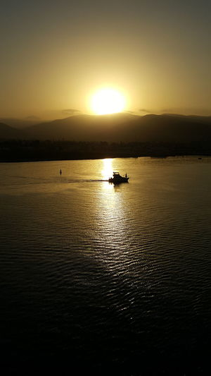 Sunset Silhouette Tranquility Nautical Vessel Scenics Sea Water Transportation Sun Reflection Nature Tranquil Scene No People Beauty In Nature Sky Outdoors Sunlight Yellow Travel Destinations Sailing Perspectives On Nature