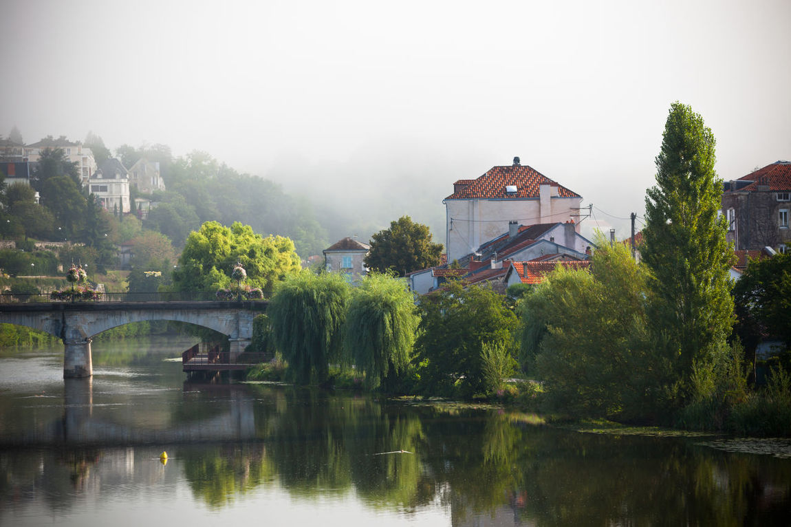 Picturesque view of Perigord town in France Architecture Beauty In Nature Bridge - Man Made Structure Building Exterior Built Structure Day Dordogne Fog France Green Mist Nature No People Outdoors Perigord Picturesque Périgueux Reflection River Scenics Town Tree Vezere Water Waterfront