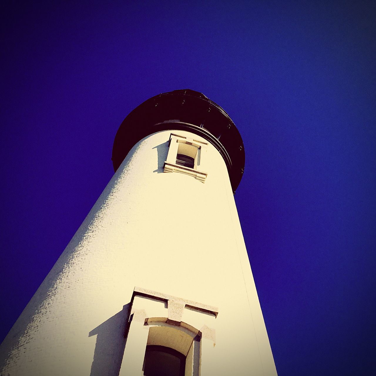 architecture, low angle view, building exterior, tower, clear sky, built structure, guidance, no people, blue, lighthouse, day, outdoors, sky, close-up