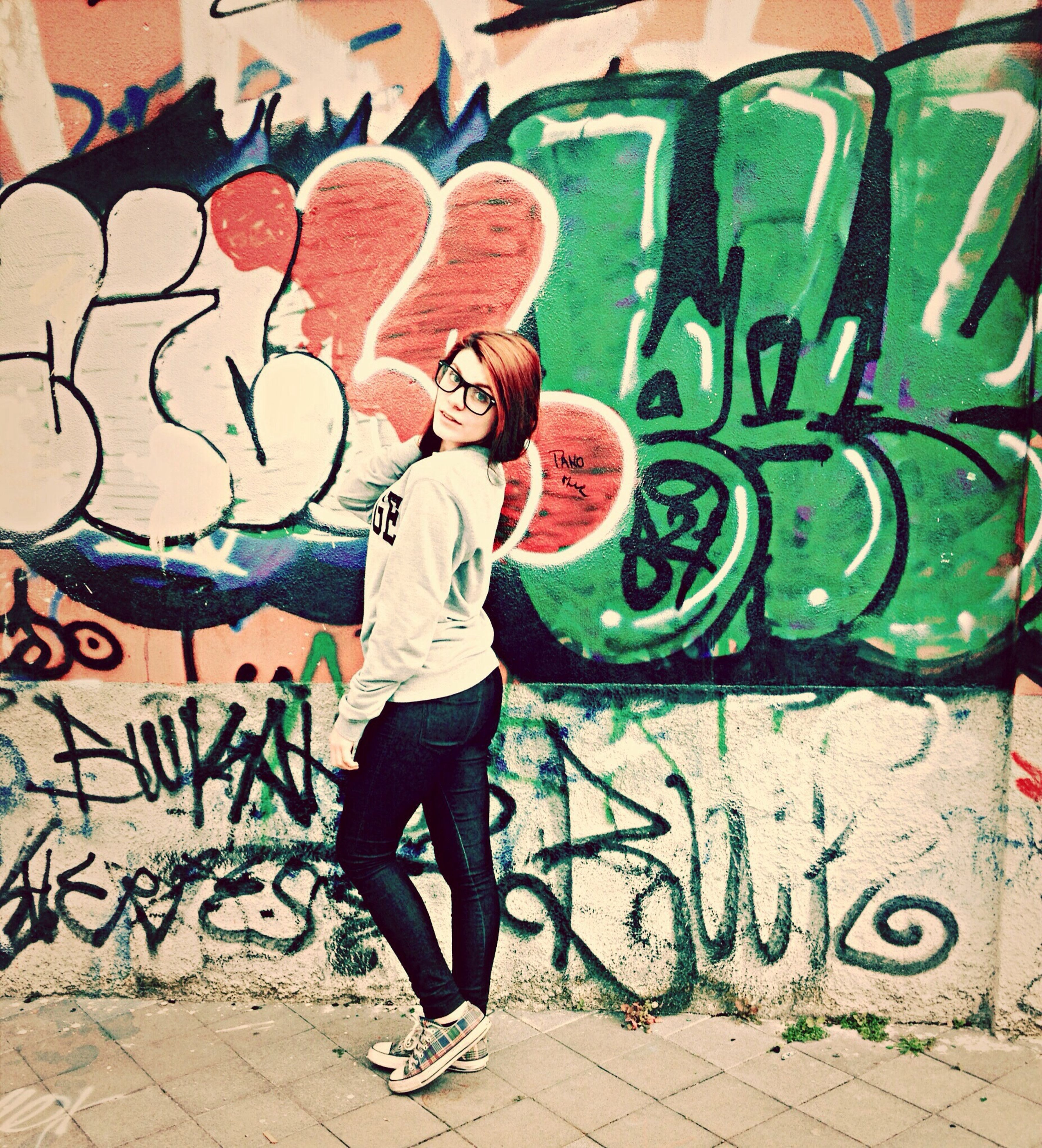 graffiti, wall - building feature, art, creativity, art and craft, lifestyles, full length, multi colored, street art, built structure, casual clothing, leisure activity, wall, architecture, text, bicycle, men, outdoors