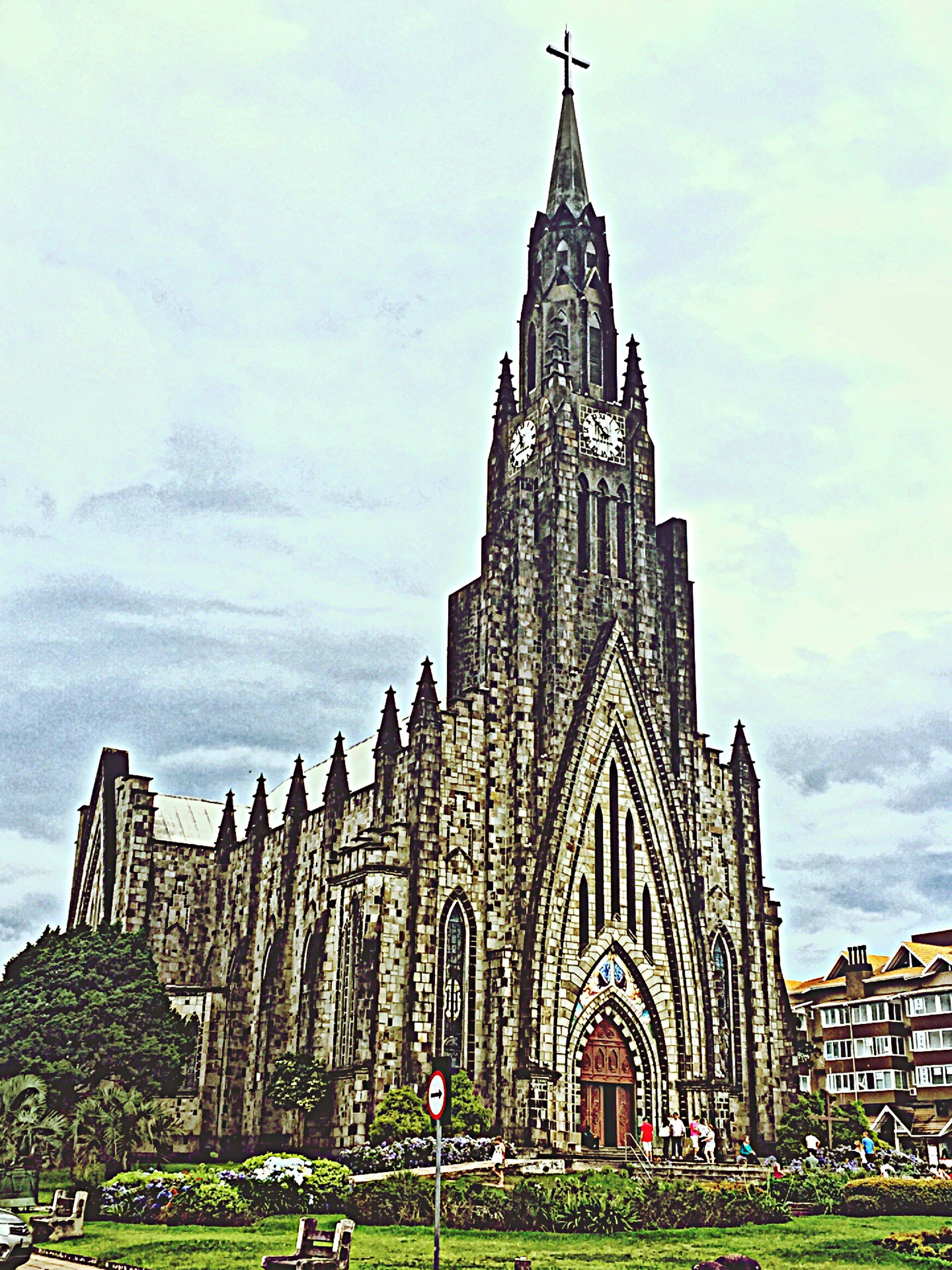 religion, place of worship, architecture, spirituality, building exterior, built structure, church, famous place, cathedral, travel destinations, sky, travel, tourism, low angle view, history, day, facade, tree
