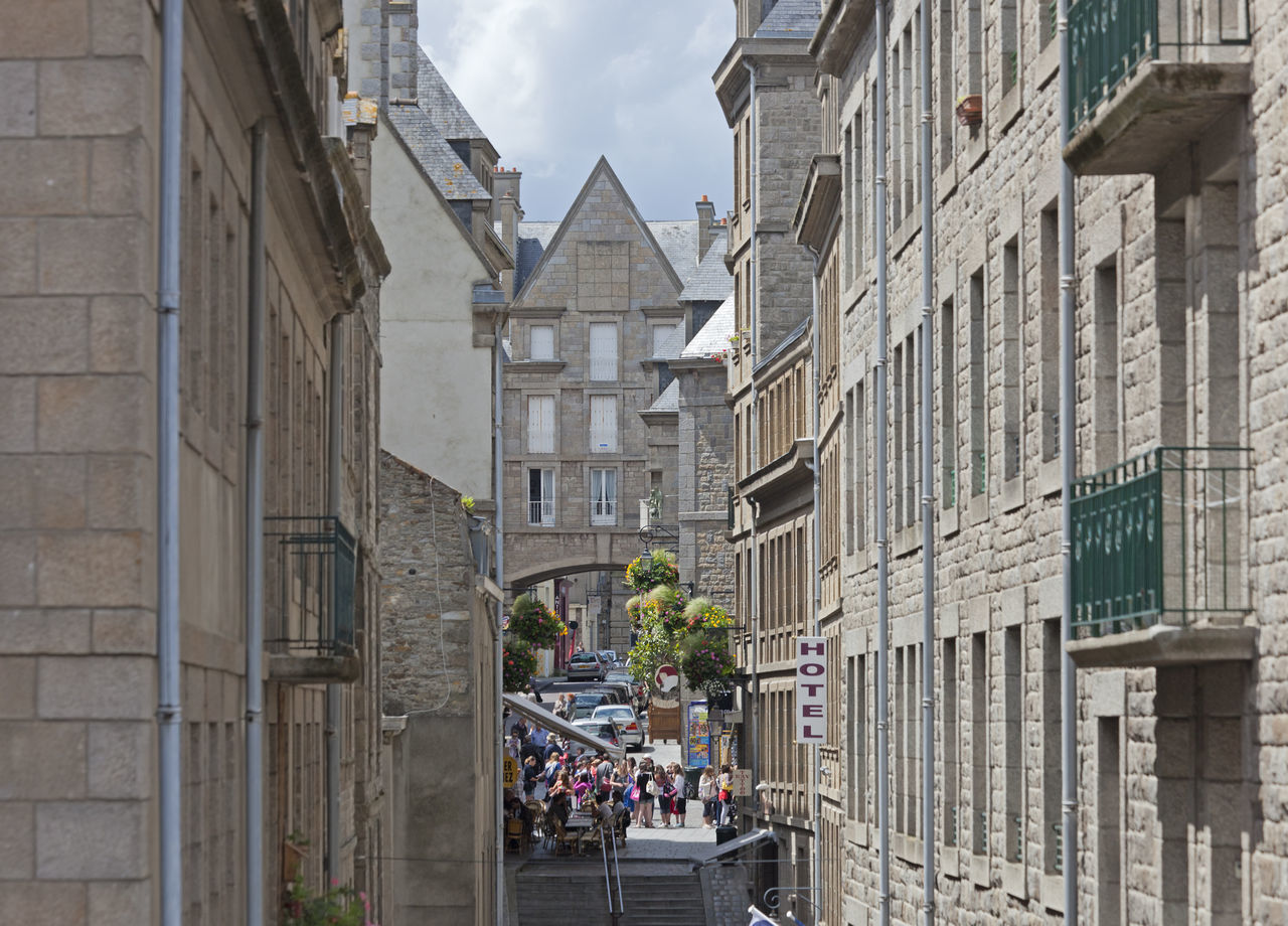 High angle view of an alley in Saint-Malo, France Ancient Ancient Architecture Architecture Brick Building Brittany Building Exterior Built Structure Cityscape Commerce Façade France Gastronomy House Intramuros Pedestrian People Residential Building Saint-Malo Steps And Staircases Tourism Townhouse TOWNSCAPE Tradition Travel Destinations Village