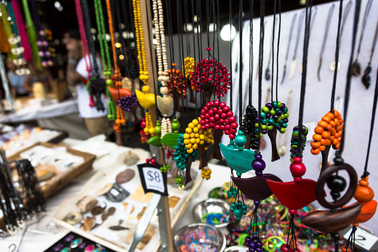 Close-Up Of Multi Colored Necklaces Hanging In Market