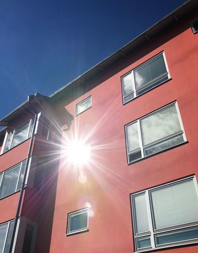 Sun and lens distortion. Building Exterior Architecture Built Structure Low Angle View Sunlight Window No People Day Outdoors Modern Sky