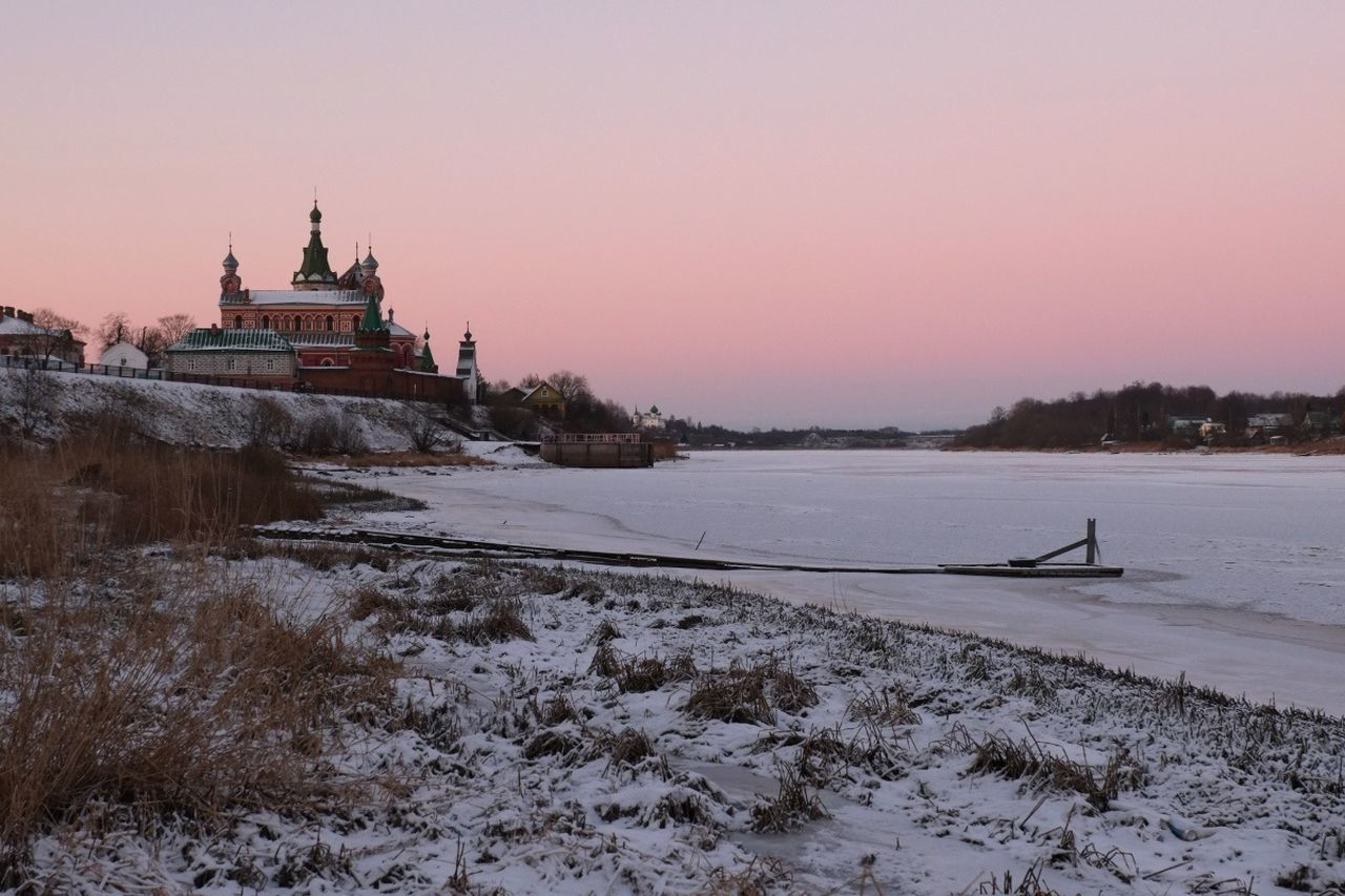 winter, cold temperature, snow, sunset, weather, nature, architecture, beauty in nature, frozen, scenics, outdoors, landscape, built structure, spirituality, tranquility, no people, place of worship, building exterior, lake, sky, clear sky, day