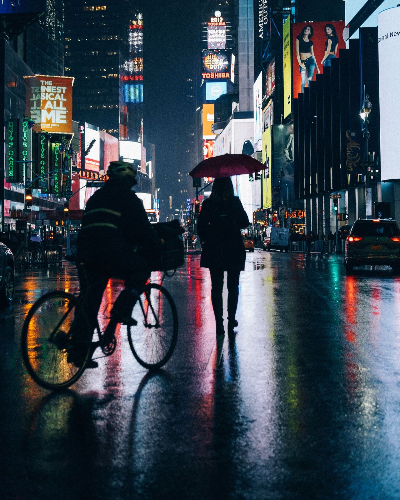 Adapted To The City of New York Bicycle Two People Rain Street Cycling Transportation Wet City Land Vehicle Outdoors Adults Only Rainy Season Night Full Length People Men Adult