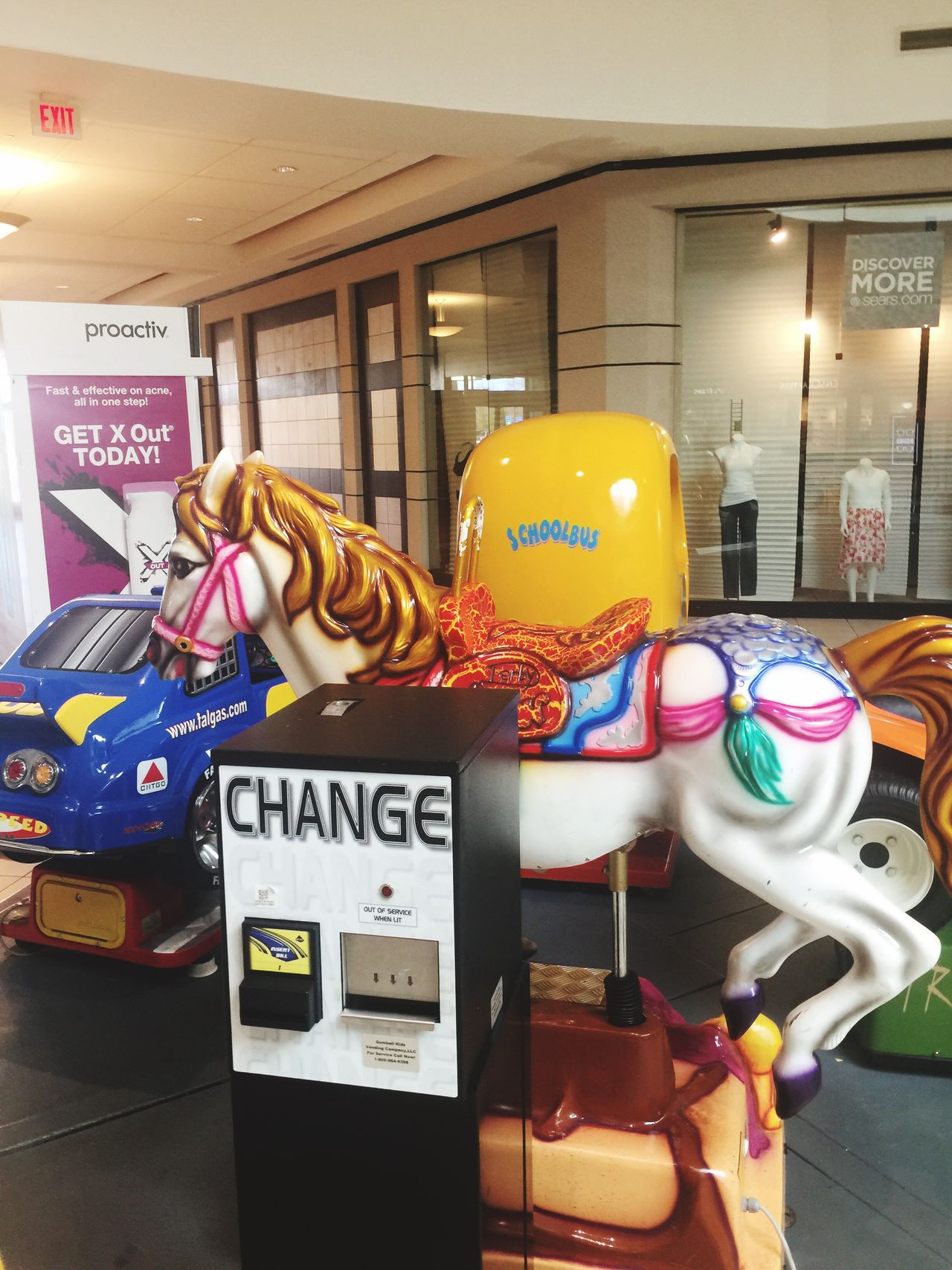 Play area the horse in a mall No People Indoors  Day Multi Colored Text Mall Coin Operated Coin Machine Play Area