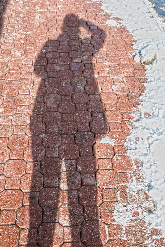 Shadow Selfie on the cobblestone sidewalks of Main Street in the Winter Backgrounds Cobblestone Day Deterioration Downtown Footpath Full Frame Geometry Old Outdoors Pattern Pavement Paving Stone Ruined Selfie Shadow Shadow Shadows Sidewalk Silohuette Snow Stone Street Textured  Tiled Floor Winter Jacket