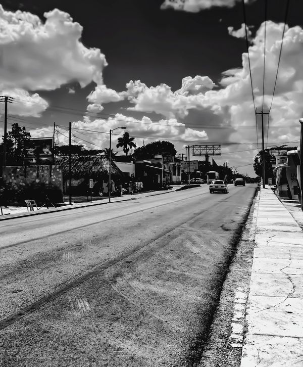 Mexican streets..... LGarciaPhotography Shot On IPhone 6 Plus Iphoneonly IPhone Shot On IPhone Olloclip Monochrome Mexico Playadelcarmen Vacation Streetphotography Clouds Sky Sky And Clouds Blackandwhite Black And White Cloud - Sky Street City Outdoors Building Exterior Built Structure Architecture Day Road Tree Vertical No People