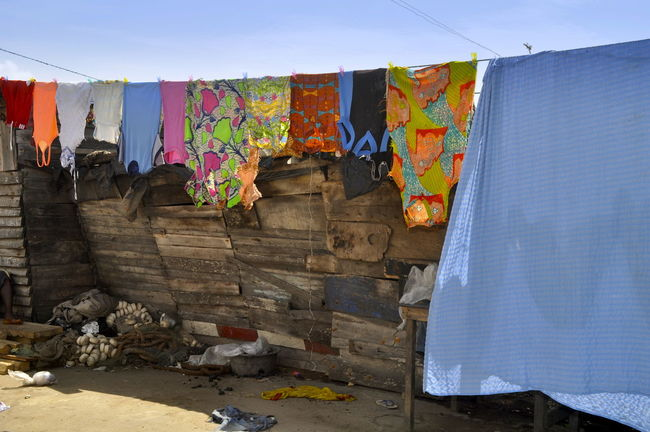 Laundry Day Africa African Blue Blue Sky Clear Sky Colorful Dirty Drying Fisher Net Ghana Hanging Laundry Laundry Day No People Outdoors Shirts Sunlight The Week On Eyem Wall Drying Clothes