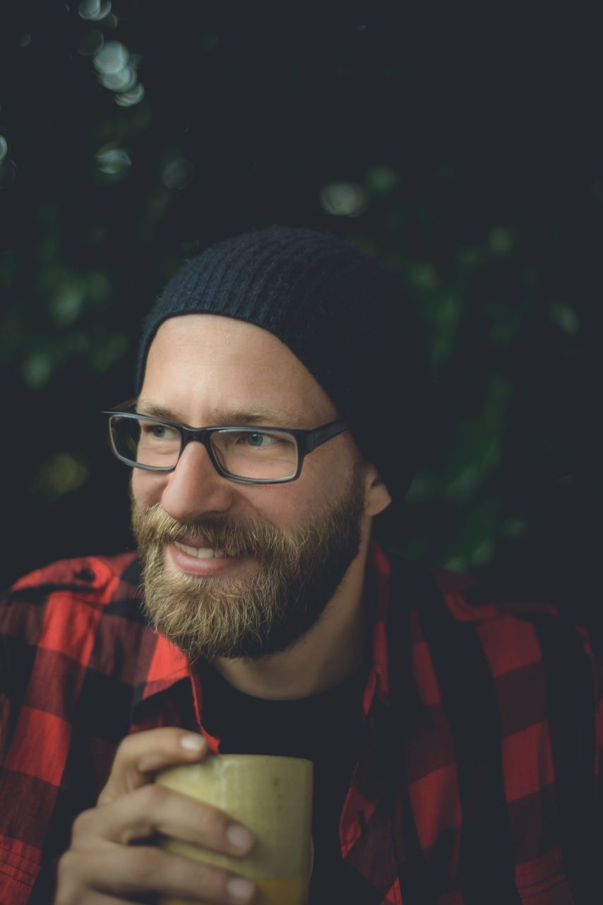 eyeglasses, beard, front view, one person, drinking, food and drink, mid adult men, real people, drink, headshot, young adult, outdoors, lifestyles, bad habit, men, portrait, day, close-up, adult, adults only, people