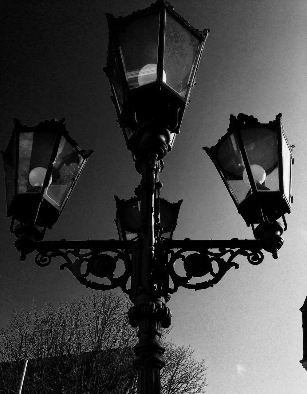 lighting equipment, street light, illuminated, low angle view, gas light, electric light, electric lamp, street lamp, no people, outdoors, electricity, night, technology, sky, close-up