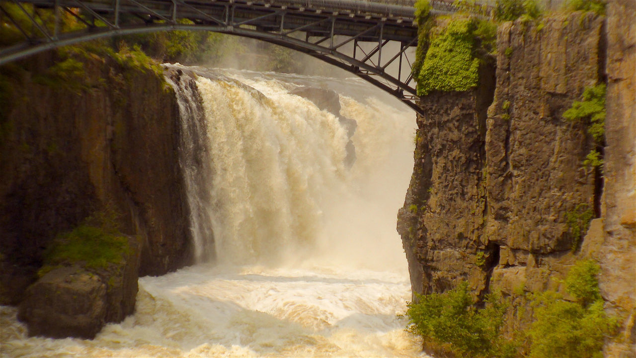 When a waterfall is angry. Beauty In Nature Bridge - Man Made Structure Bridge Over Waterfall Dam Day Hydroelectric Power Motion Nature No People Outdoors River Roaring Waterfall Tree Water Waterfall