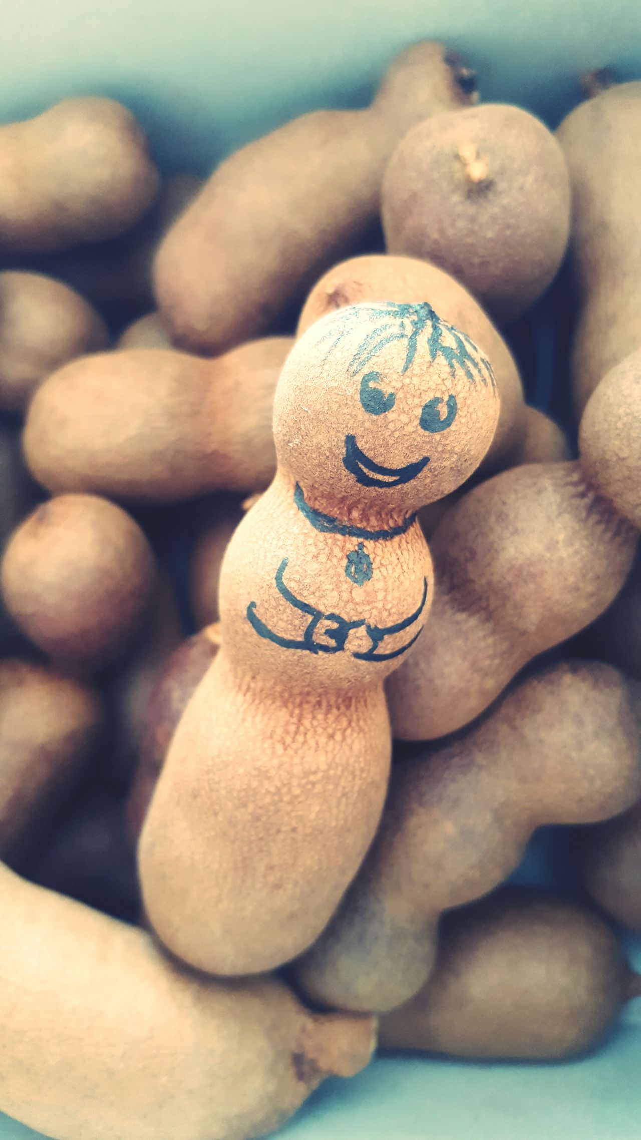 Close-up Food Human Body Part Human Hand One Person Adult People Outdoors Day Cultures Sweet Tamarind Exotic Fruits