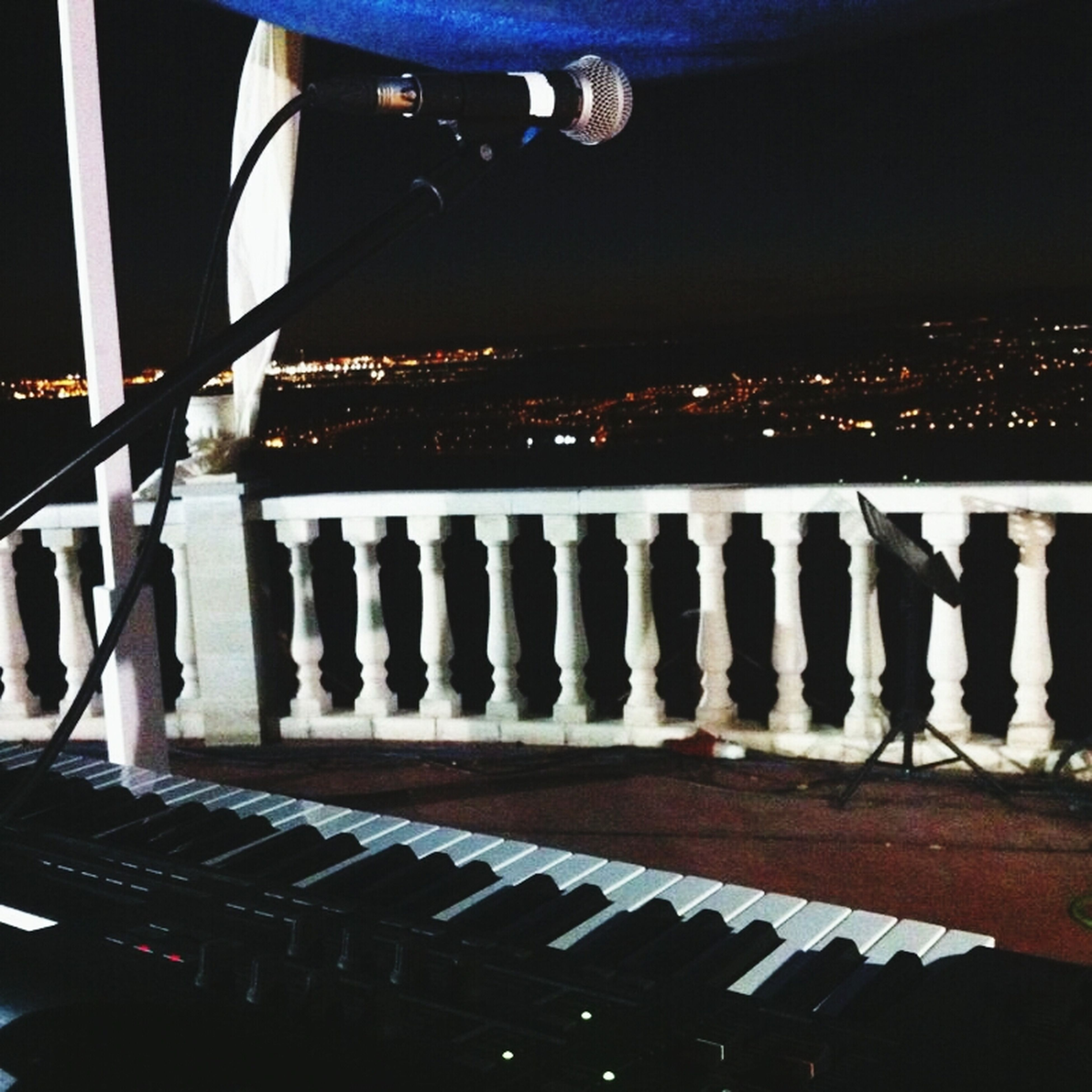 illuminated, night, in a row, lighting equipment, indoors, arts culture and entertainment, metal, built structure, high angle view, hanging, railing, musical instrument, music, connection, transportation, low angle view, architecture, no people, bridge - man made structure