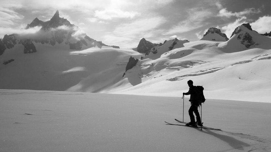 """Awesome landscape during the downhill of the """"Valle Blanche"""" at Chamonix Mont Blanc. It's a dangerous route full of ice hills Chamonix-Mont-Blanc Share Your Adventure Valle Blanche Mountains Panasonic Lx100 Black And White Snow Traveling Sports Photography Horizons Adrenaline Junkie Showcase: February Photography In Motion Black & White Sunset Silhouettes Monochrome Photography Dirator's Bests Traveling Home For The Holidays Finding New Frontiers Snow Sports Miles Away Uniqueness Done That."""