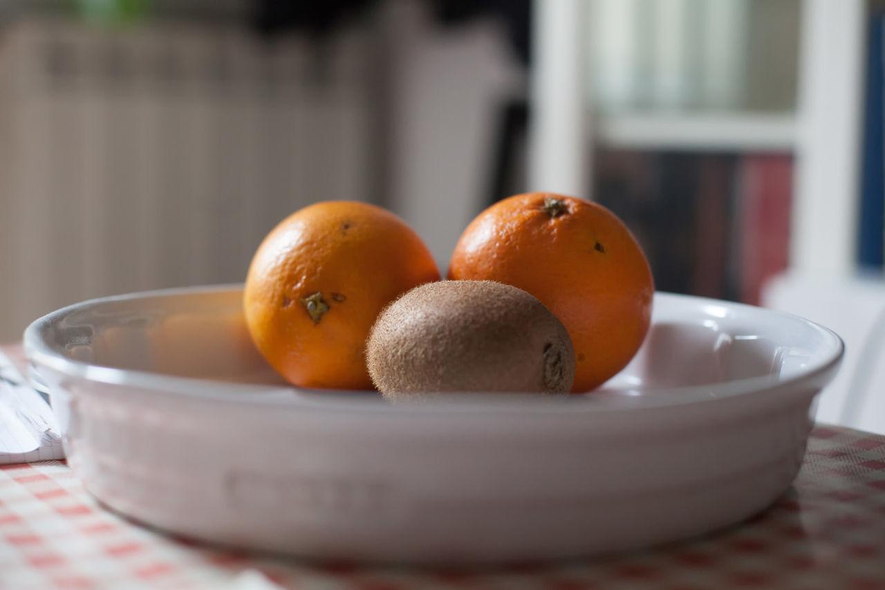 Orange and Kiwi Bowl Close-up Day Focus On Foreground Food Food And Drink Freshness Fruit Healthy Eating Indoors  Kitchen Kiwi No People Orange Plate
