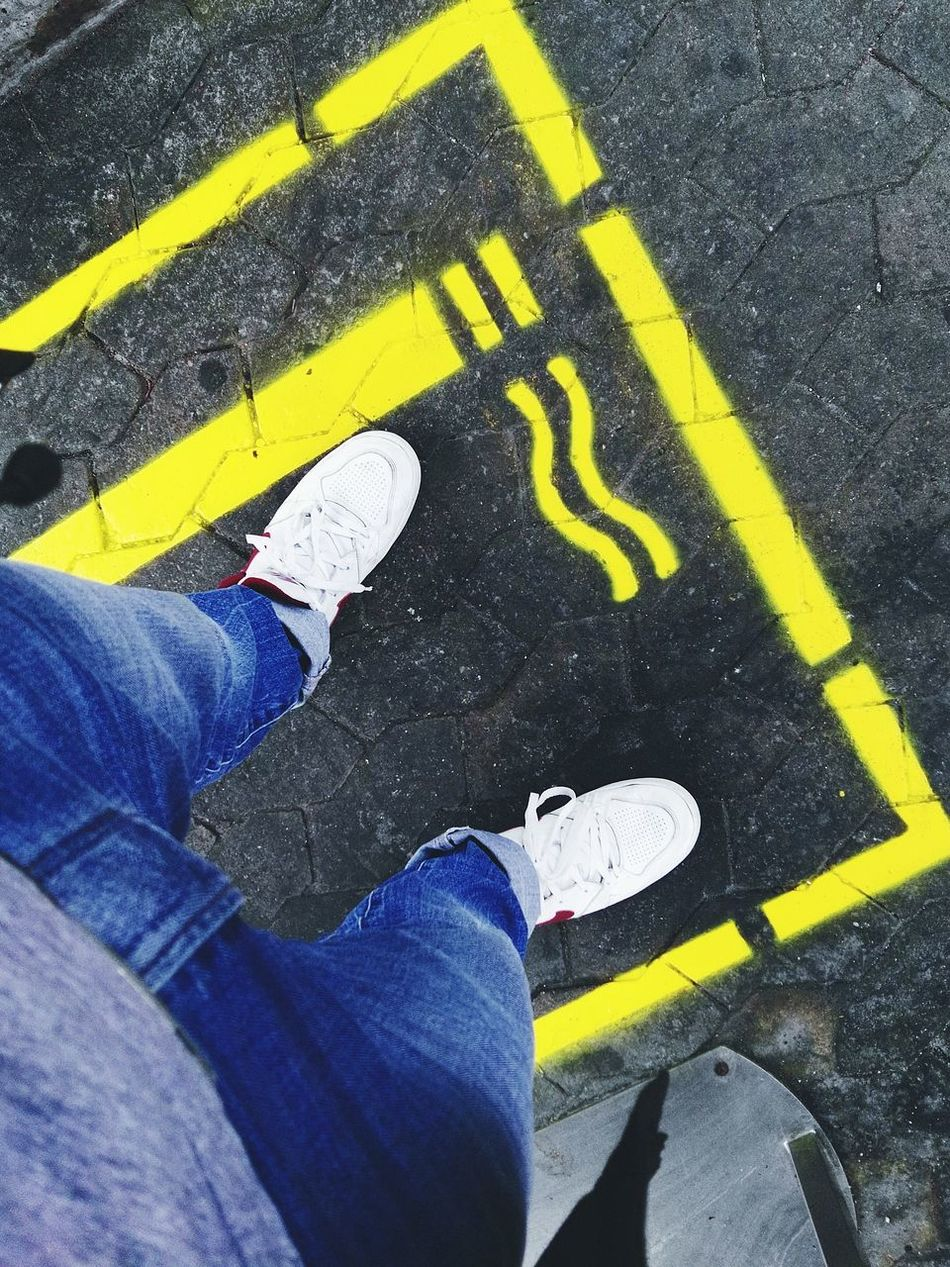 Real People Low Section Road One Person Lifestyles High Angle View Human Leg Human Body Part Yellow Standing Outdoors Leisure Activity Day Men Close-up People Adult Multi Colored
