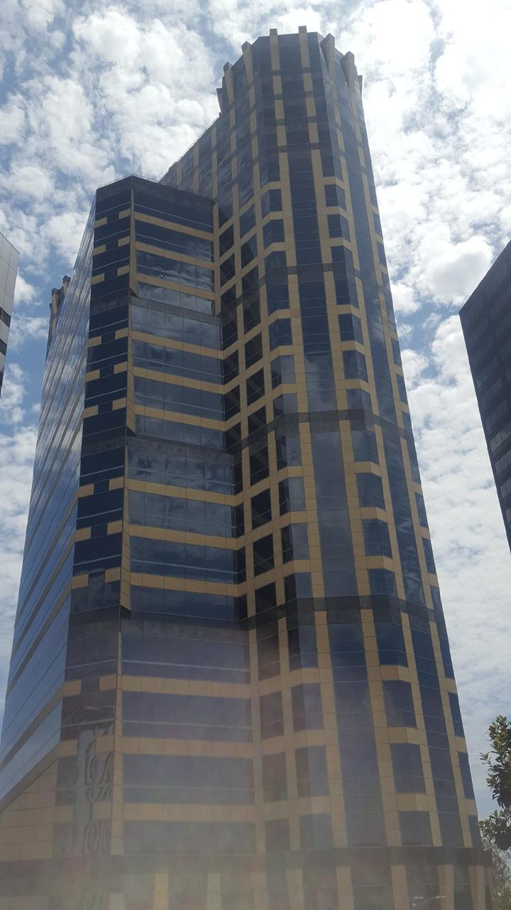 low angle view, architecture, sky, building exterior, built structure, skyscraper, cloud - sky, tower, modern, day, outdoors, tall, no people, growth, city